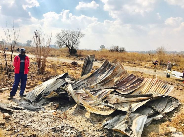 Nathal Basemlambeli stands next to his demolished shack in Old Brakpan township after police removed 300 shacks from the area on Tuesday.