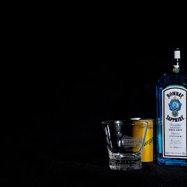 Gin & Tonic by John Holmes - Food & Drink Alcohol & Drinks ( can, glass, black background, blue, yellow, tonic, bottle, gin, minimlal )