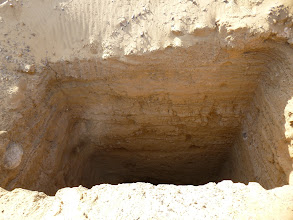 Photo: Very deep looting hole that discovered a shaft tomb.