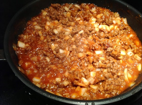 Stir and blend well.  Cover and cook until onions are tender.