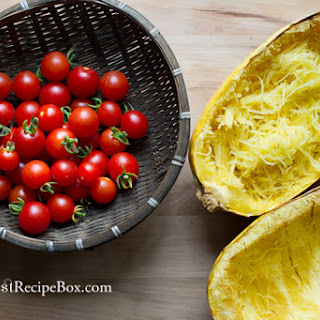 Baked Spaghetti Squash with Tomatoes and Parmesan Cheese.
