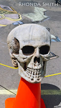 Photo: The skull display in front of the chalk design area.