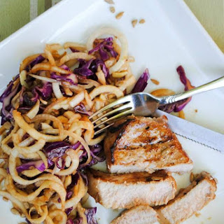 Grilled Pork Chops with Asian Jicama and Cabbage Slaw.