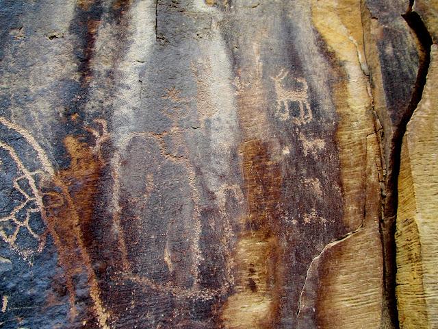 Petroglyph figures, including a canine