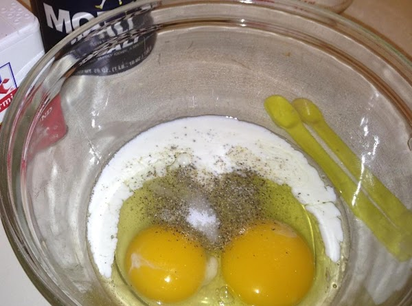 In a small mixing bowl whisk the eggs, half and half, and salt and...