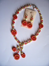 "Photo: PCF- 101 Necklace and earrings set. Polymer Clay Hibiscus cane beads, pearl and glass beads. 17"" $99.00"