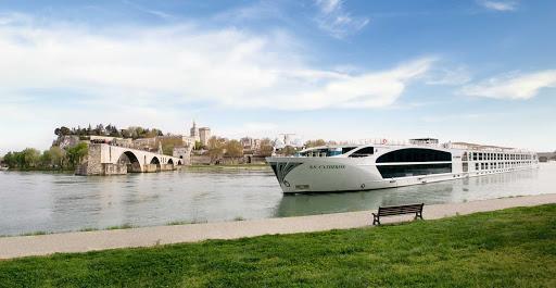 uniworld-ss-catherine-in-avignon - The S.S. Catherine cruises the Rhone River past Avignon, France.
