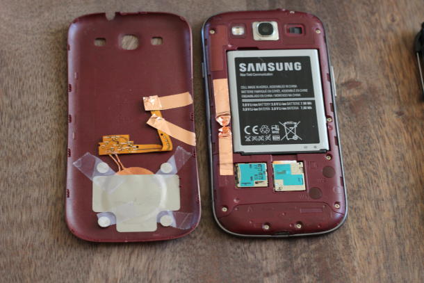 Photo: Adding wireless charging to the S3: http://howto.cnet.com/8301-11310_39-57566806-285/this-easy-hack-adds-wireless-charging-to-samsung-galaxy-s3/
