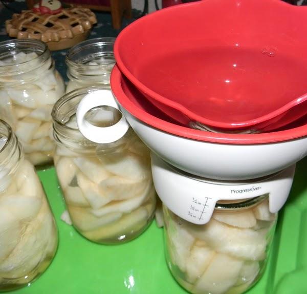 ladle hot water into jars , leaving 1/4 head space add lids Turn jars upside down...