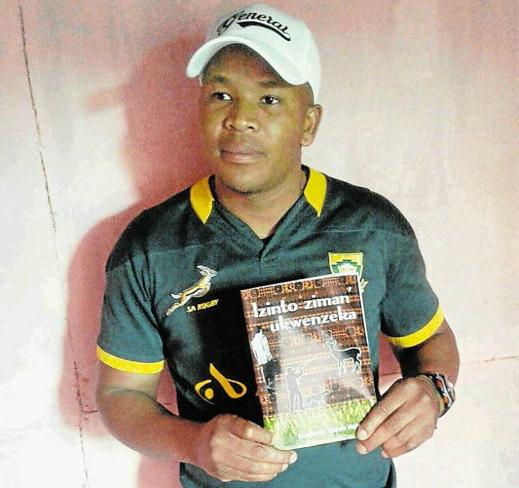 Author Bongekile Calvin Nqiyama with his book that was published last month.