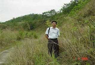 Photo: CHN-UR14 - The stadium/college site five years later. Fully stable with native plants established. Xia Hanping China Vetiver Champion.
