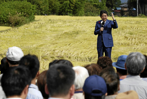 Japanese Prime Minister Shinzo Abe attends a campaign rally in Fukushima on October 10 2017 — the same day a court ruled on the government and Tepco's joint liability for the 2011 Fukushima nuclear disaster. Picture: REUTERS/Toru Hanai