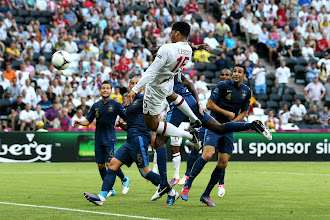 Photo: DONETSK, UKRAINE - JUNE 11:  Joleon Lescott of England scores the first goal during the UEFA EURO 2012 group D match between France and England at Donbass Arena on June 11, 2012 in Donetsk, Ukraine.  (Photo by Ian Walton/Getty Images)