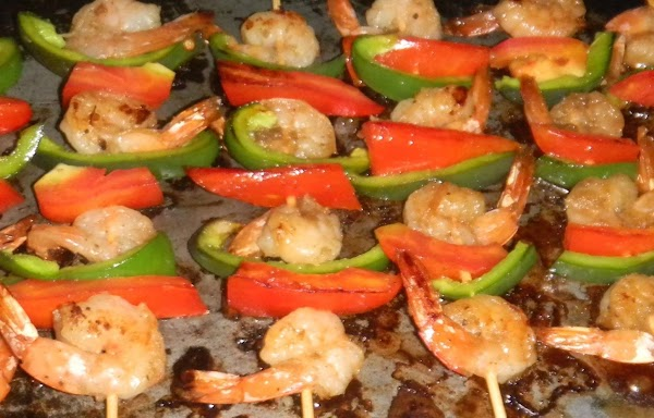 Marinate shrimp in vanillated spicey sauce, slice sweet peppers and tomatoes in thick slices....