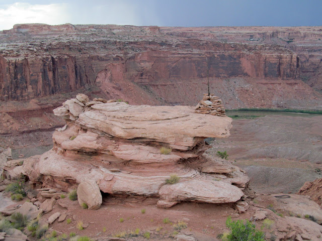 Large cairn on a rocky knoll above Labyrinth Canyon