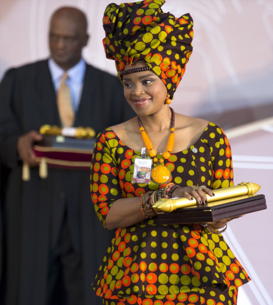 Winnie Madikizela-Mandela's granddaughter, Zoleka Mandela receives the Order of Luthuli in silver on behalf of her grandmother during the National Orders Awards ceremony on April 28, 2016 in Pretoria.