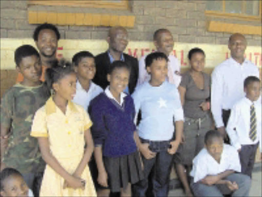 FOR THE CHILDREN: Rudi Page, back right, and his team with some of the children who are under Raffa's wing. Pic. Katlego Moeng. 30/10/2008. © Sowetan