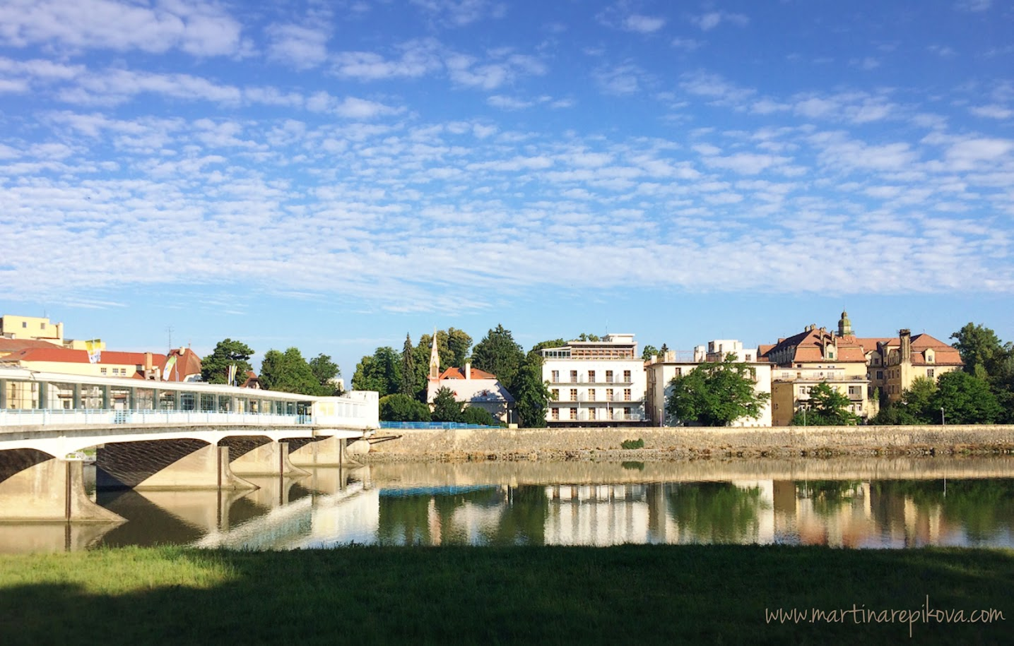 The Colonnade bridge and buildings on the right bank of the river Váh, Piešťany, Slovakia