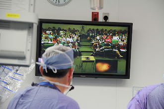 Photo: The virtual field trip utilized video-conferencing technology, high speed Internet and the hospital's integrated operating room cameras and imaging systems to virtually link the OR to the classroom.