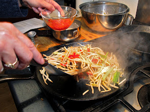 Photo: adding the chilli sauce and green onions