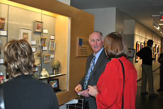 Photo: Attendee purchases a piece of art from the gallery display case.