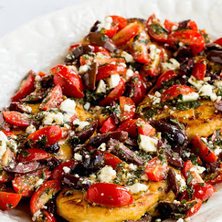 Sauteed Greek Chicken with Tomato, Olive, and Feta Topping.