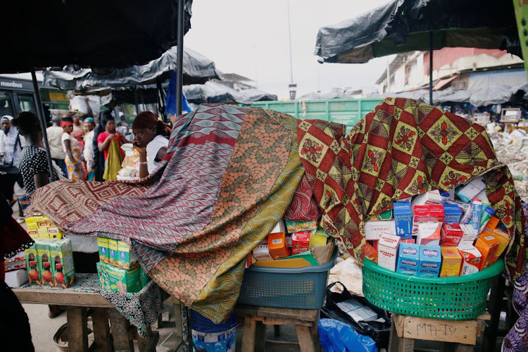 A street vendor sells illegal and fake drugs in a street of Adjame in Abidjan, Ivory Coast, on October 13 2018.