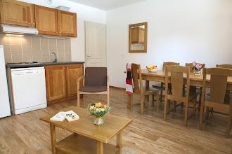 Photo: Coin cuisine et coin salle à manger d'un appartement 3 pièces pour 6 personnes