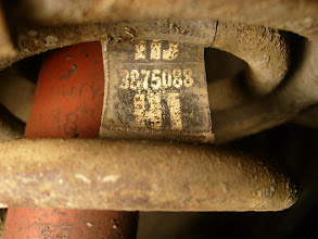 Photo: GM factory tag on the front spring with code HJ and part number 3875088 indicate HD suspension RPO F41