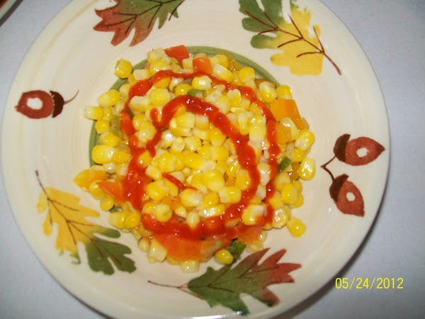 When the corn is done top with hot sauce if you want a little...