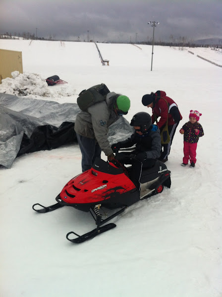 Photo: Max taking his first snowmobile ride