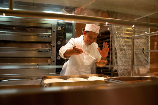 costa-victoria-pizza.jpg - A cook makes pizzas aboard Costa Victoria from Costa Cruises.
