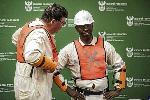 Fail: Mineral Resources Minister Mosebenzi Zwane tours Doornkop mine, west of Johannesburg. The department he heads has suffered three adverse court findings since November, with the High Court in Pretoria pointing out a 'high degree of institutional incompetence' on the part of the minister. Picture: BLOOMBERG