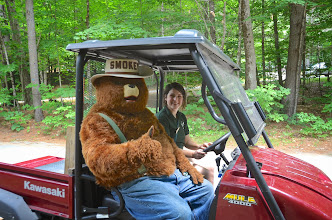 Photo: Smokey Bear riding in the park truck at Jamaica State Park by Linda Carsen-Sperry