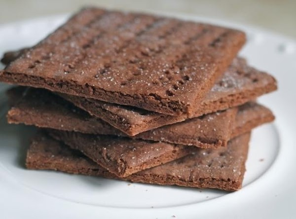 Mix together the crushed chocolate graham crackers, butter, walnuts and brown sugar and press...