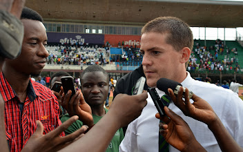 Photo: Local Media rush to interview Coach McKinstry moments after the final whistle [Leone Stars v Swaziland 31 May 2014 (Pic: Darren McKinstry)]