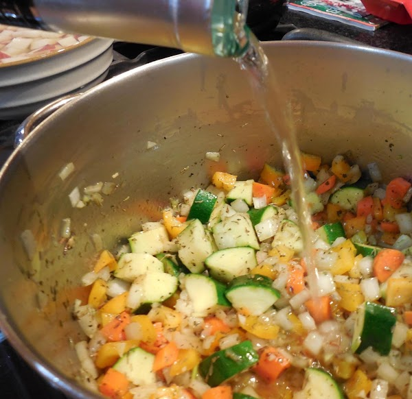 Add wine and simmer for another minute or so.
