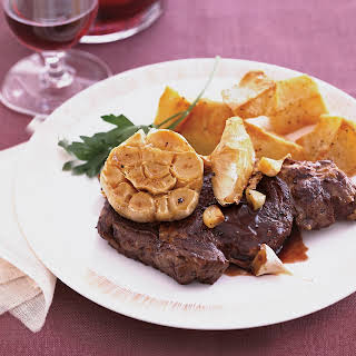 Bison Rib Eye Steaks with Roasted Garlic.