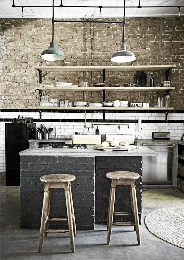 The concrete counters in the kitchen create a utilitarian and unpretentious tone.