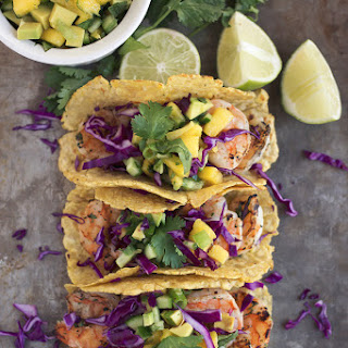 Grilled Cilantro Lime Shrimp Tacos with Avocado Mango Cucumber Salsa.