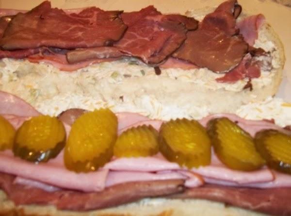 Place pickles on bottom half. Press halves together.