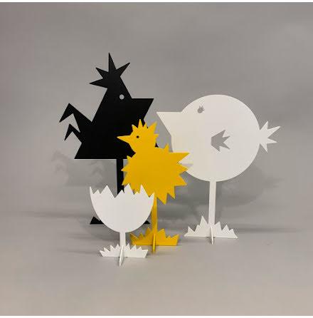 Tuppfamilj med gul kyckling
