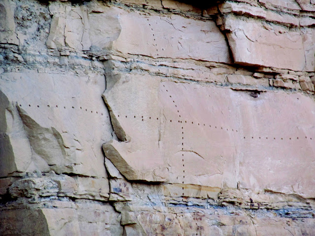 Drill holes in a cliff