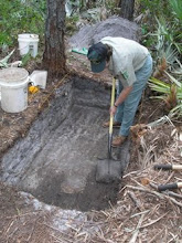 Photo: Kimbrough, excavating an archaeological feature.  Osceola National Forest (2006).