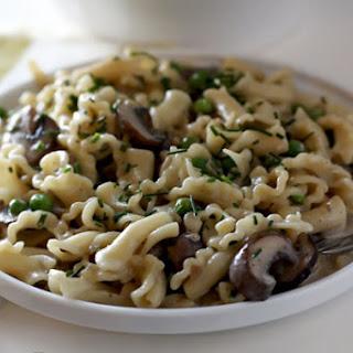Pasta with Mushrooms, Peas, and Creamy Camembert Sauce.