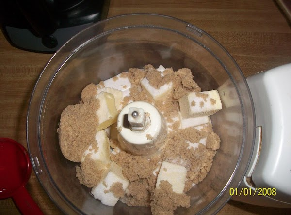 In food processor or large mixing bowl, cream the butter and both sugars together...
