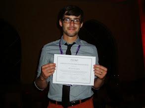 Photo: Evan with his Flash Presentation award