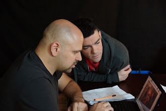 Photo: Director and actor compare takes.