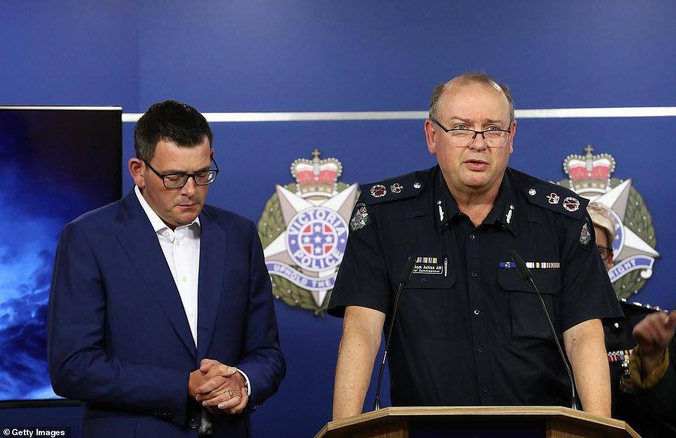 5975936-6370669-Victoria_Police_commissioner_Graham_Ashton_and_Premier_Daniel_An-m-12_1541758822169