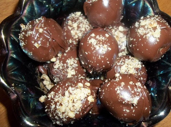 Dip the balls in chocolate. You can roll or sprinkle with nuts, cookie crumbs,...